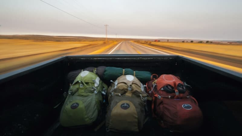 Three backpacks in a jeep