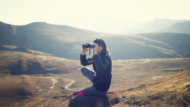 Girl using binoculars