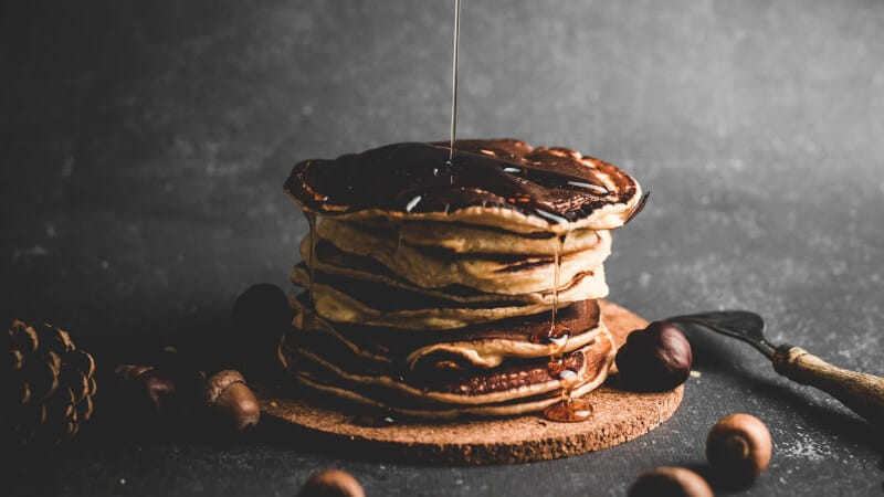 Pancake dripping with maple syrup