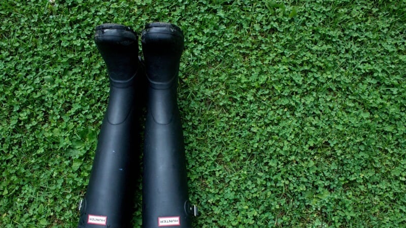 Rain boots in the grass