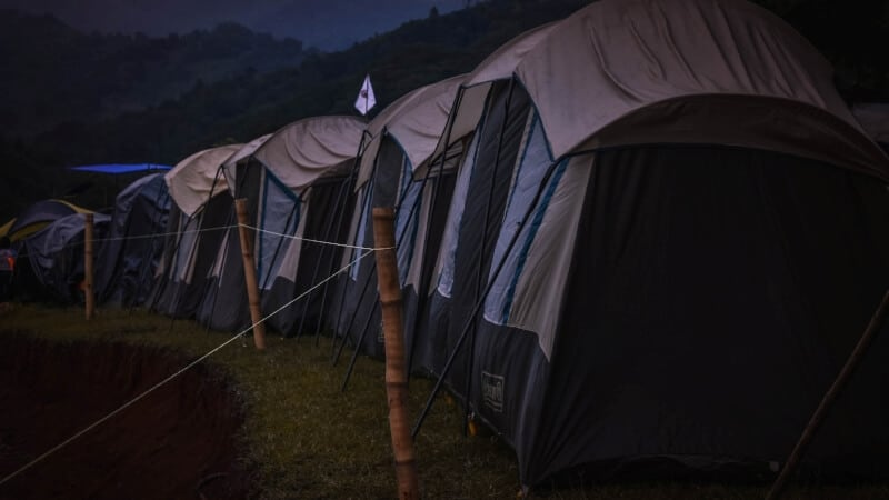 Multiple tents in the dark