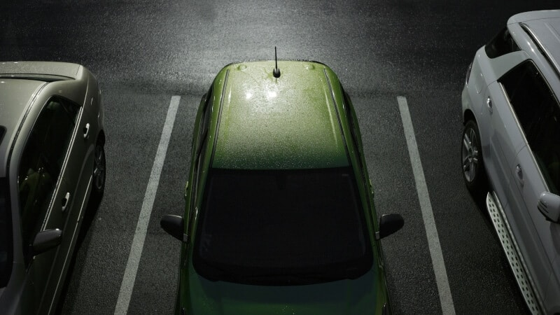 Three cars in a parking lot