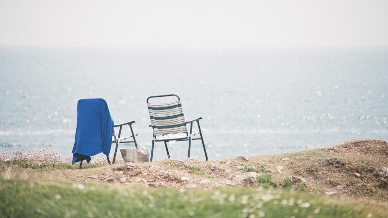 Two folding chairs with a sea view