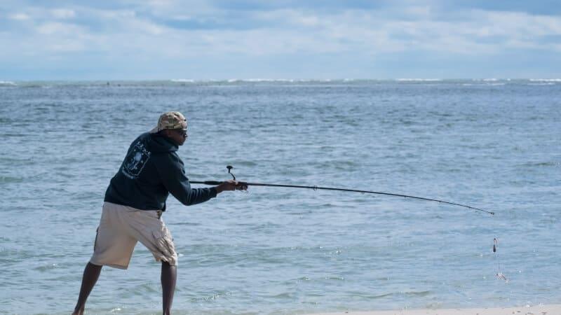 Man fishing in the shore