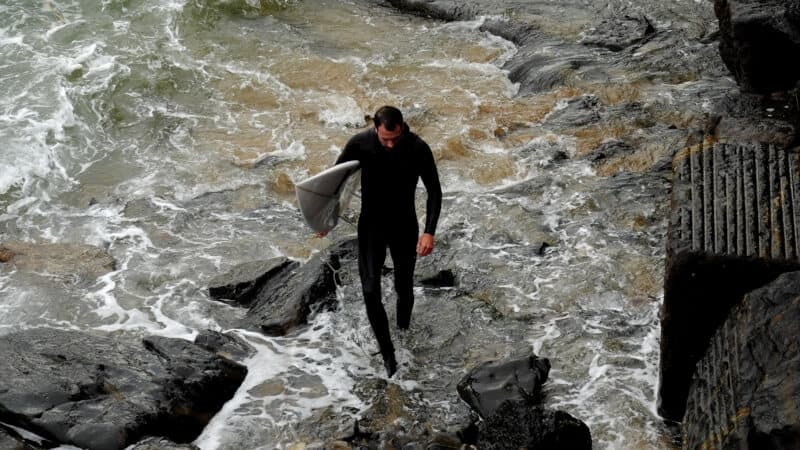 Topview of a man wearing a black wetsuit