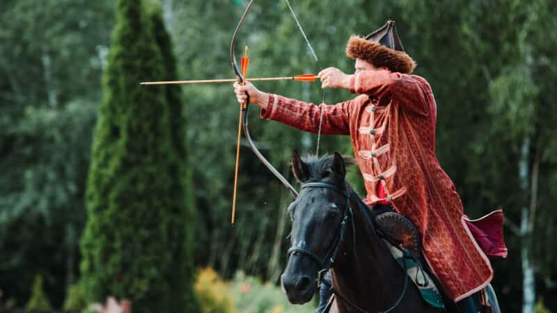 man releasing arrow