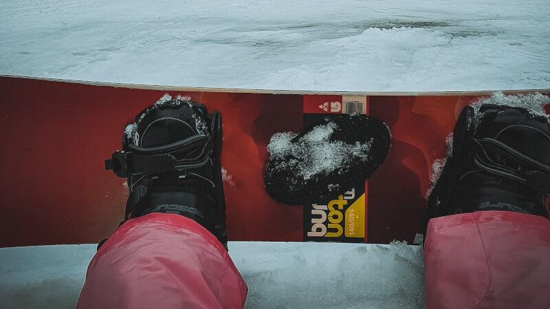 feet on snowboard