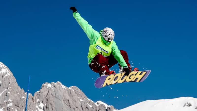 green snowboarder