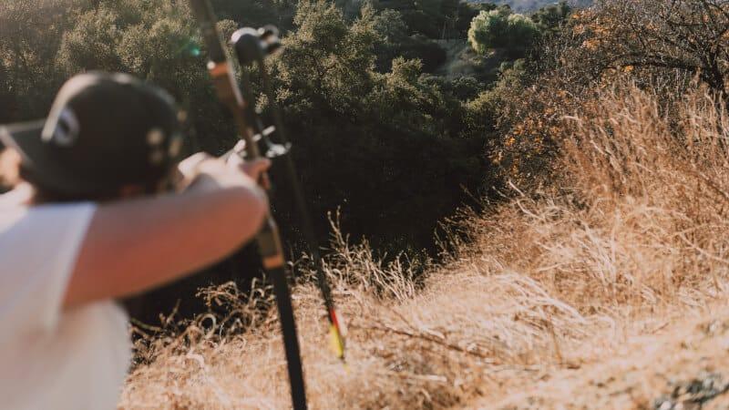man shooting a bow