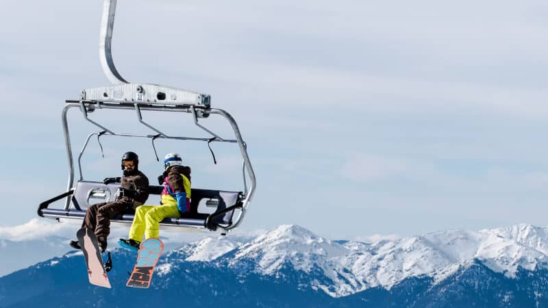 snowboarders on a lift