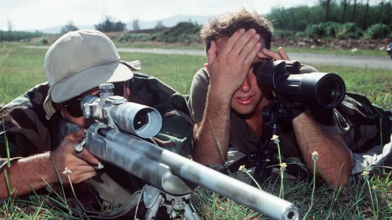 man using spotting scope